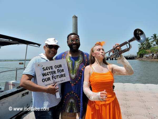 Saskia Laroo playing trumpet sailing across Mandovi