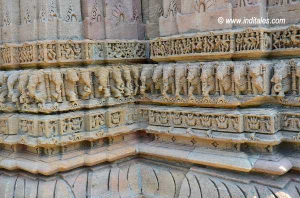 Inverted lotus petals, panel of elephants carrying temple on their back and human life. carved at Sun Temple Modhera
