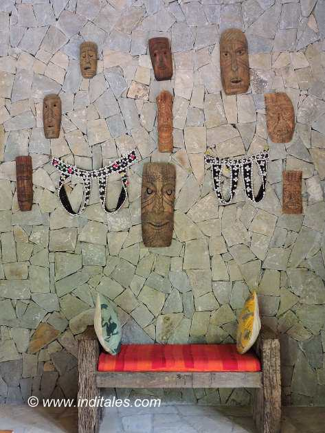 Kanha Earth Lodge masks on walls