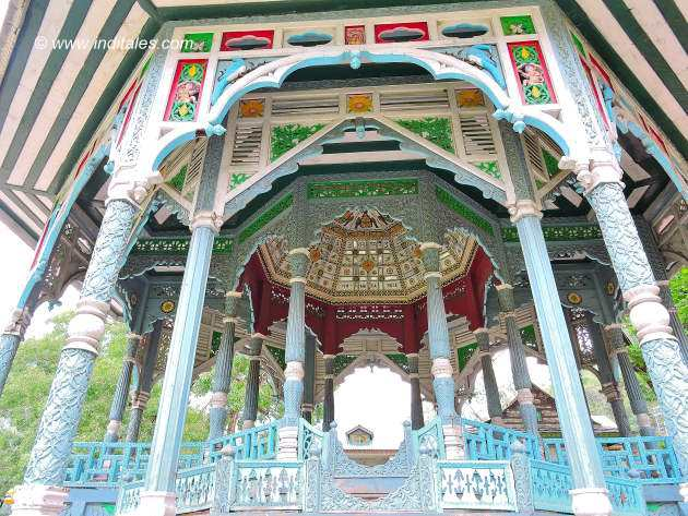Colorful wooden carvings of the public audience canopy at Padam palace