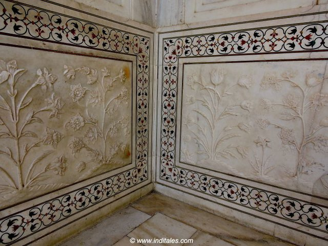Play of marble carving and inlay on a border that goes around base of Taj Mahal