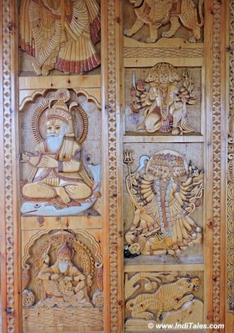 Carved wooden panels of Hatu Temple , near Shimla India