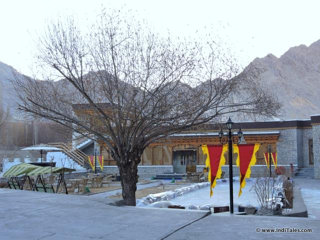 Snow clad outside view of the The Grand Dragon Hotel, Ladakh