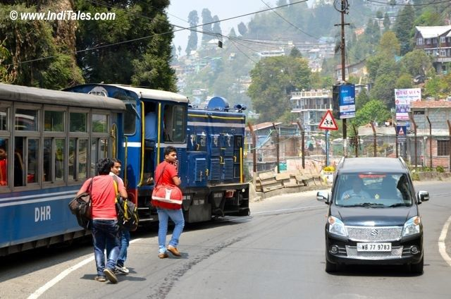 Vehicles, Pedestrians and Darjeeling Himalayan Railway - use the same road