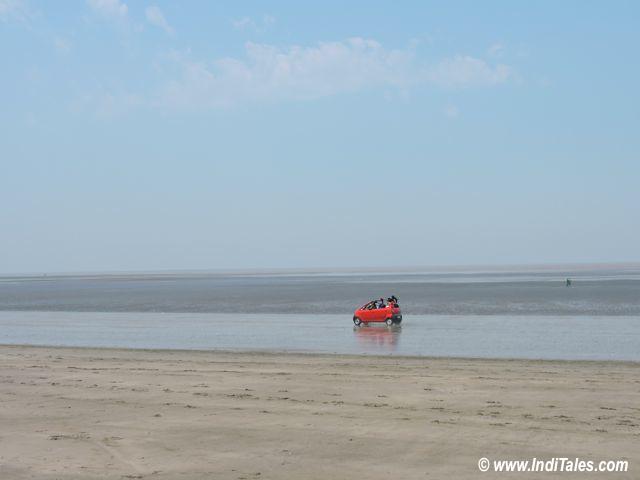 Red Car racing on Jampore beach, Daman