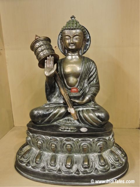 Buddha with Prayer Wheel as Sikkim Souvenirs