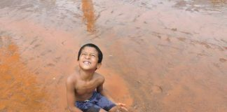a little boy in mud at chikal kalo festival, Goa