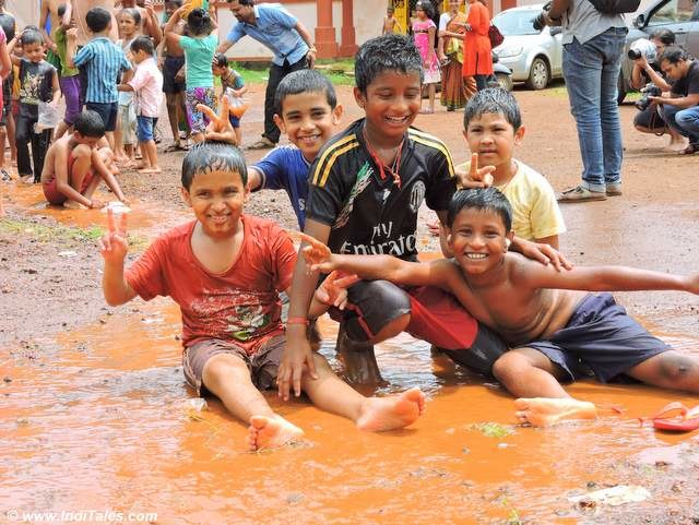 Boys playing in mud at Chikal Kalo, Goa