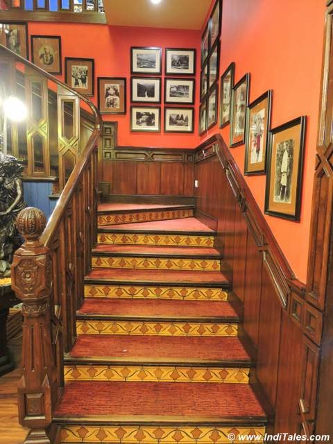 Wooden Staircase with old black & white pictures