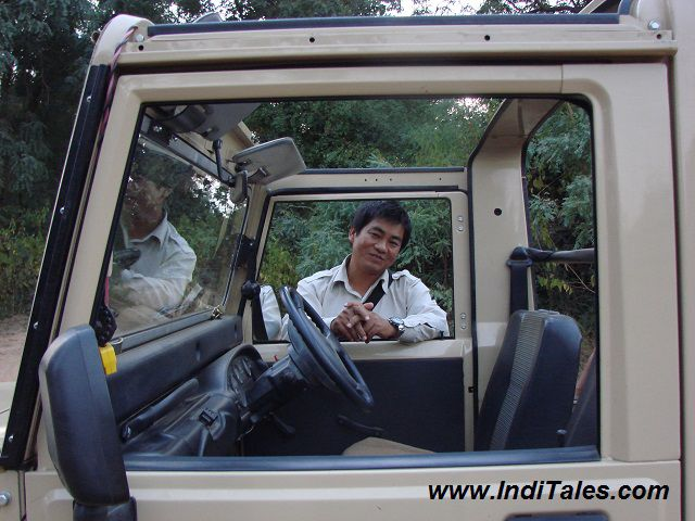 Naturalist with a safari vehicle