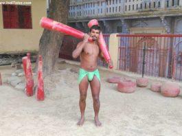Wrestler exercising with jodi at Tulsi Akhada