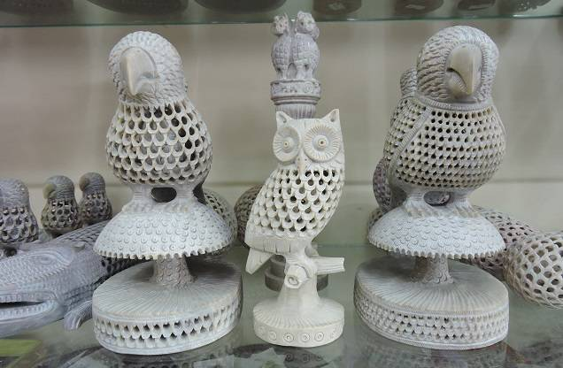 Intricately carved birds in stone