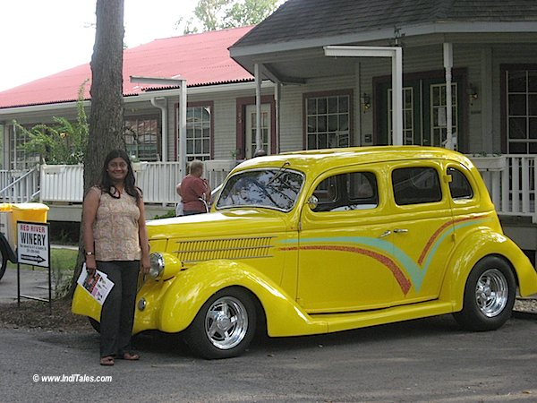 anuradha goyal with a yellow Vintage Car at Old Spring Town Houston