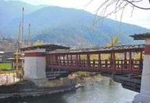 Old style wooden Bridge over a river in Bhutan