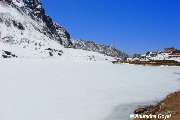 Frozen Tsomgo lake or Changu lake bed by the mountains