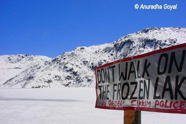 Warning board not to walk on the Frozen Tsomgo lake