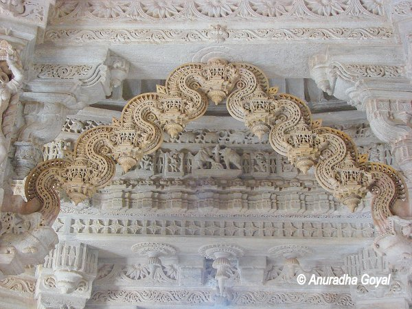 Intricately carved marble Toran at Chaumukha Jain Temple