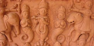 Terracotta Tablet depicting Krishna on top of 5 hooded snakes at Urusvati Museum of Folklore