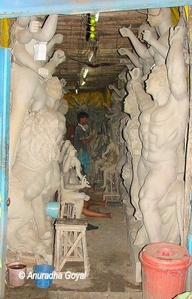 Kumartuli Idol Makers In-process idols stacked along
