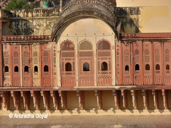 Intricate wooden Jaali works on the windows at City Palace, Alwar