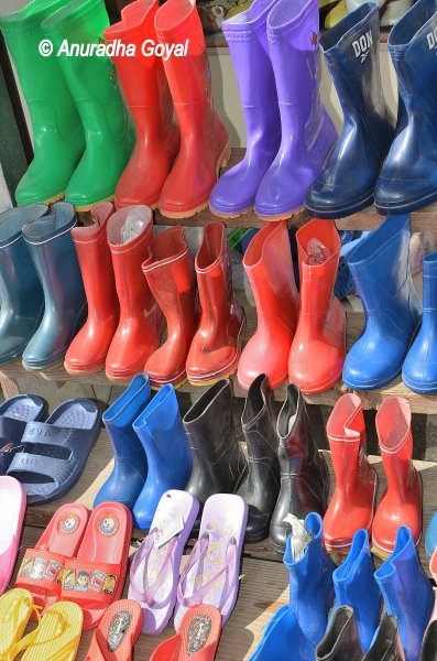 Colorful plastic shoes on display at a Bomdila shop