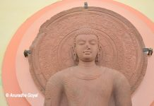 Buddha statue in Mathura School of Art style in Red Stone at Mathura Museum