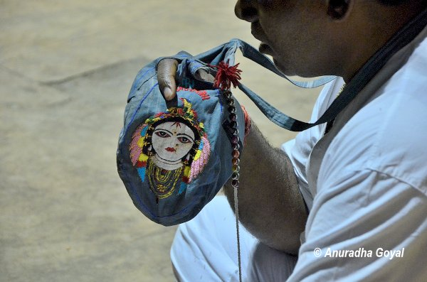 A devotee praying to Radha Krishna at Braj Bhoomi