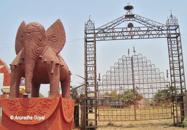 Traditional storytelling metal gates at Purkhauti Muktangan