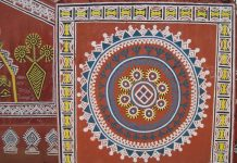 Tribal motifs on the walls of Purkhauti Muktangan