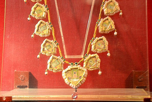 Jewelry with miniature paintings on display