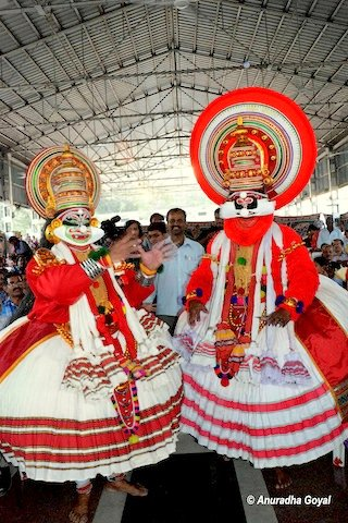 Kathakali performers mix with the audience to engage