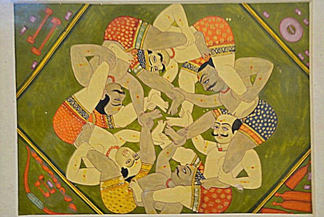 Miniature painting showcasing entangled wrestlers at Bharat Kala Bhavan, BHU
