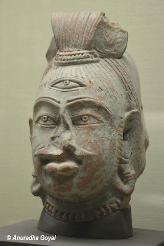 Shiva Head Stone Sculpture on display