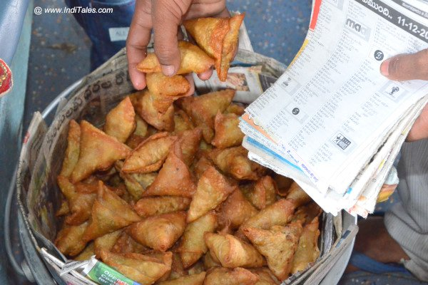 Local crispy Samosa vendor doing brisk business on the Araku train