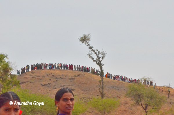 Villagers line up to see MP landing in a helicopter