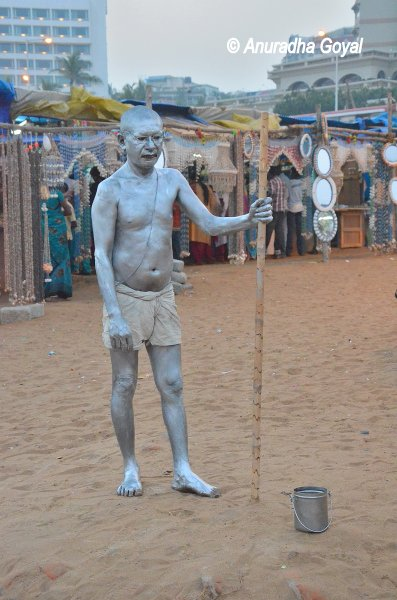 Mahatma Gandhi look-alike in the silver color painting by the Ramakrishna Beach