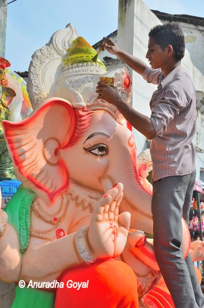Painting the Ganesha Idol during Ganesh Chaturthi