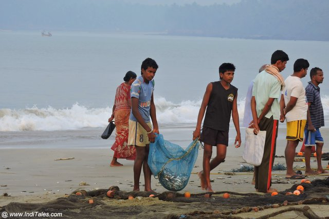 Traditional fishermen with their share of the morning catch fish
