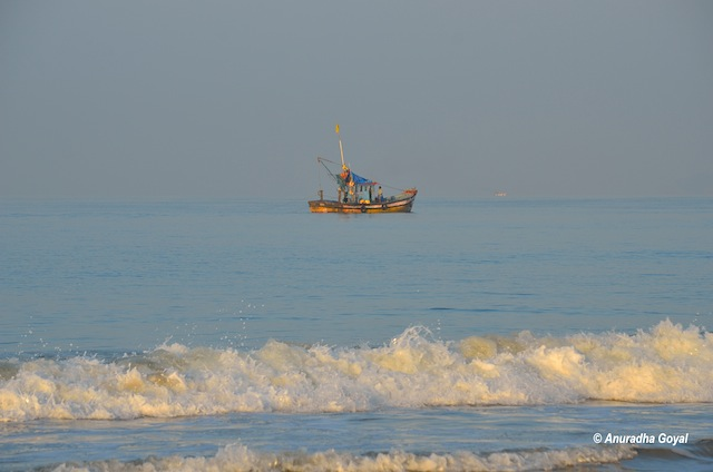 Fishermen sailing out to seas early morning at Utorda beach