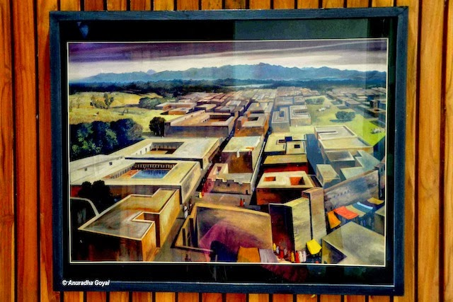 A painting depicting the old city beneath Chandigarh