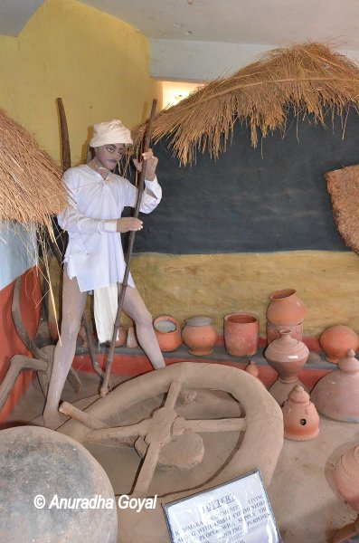 A depiction of a tribal potter at Araku Tribal Museum