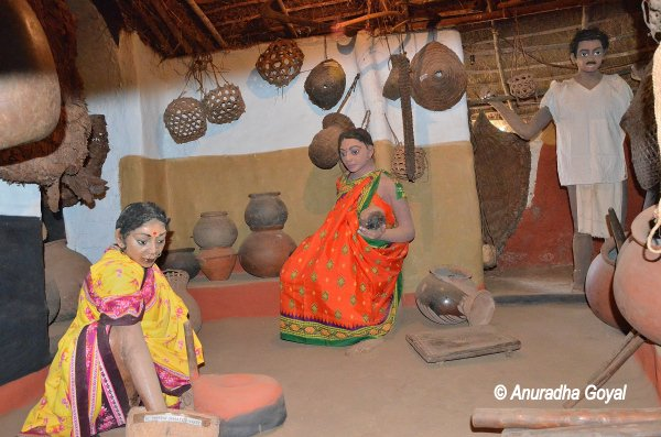 A depiction of tribal women's daily routine at Araku Tribal Museum