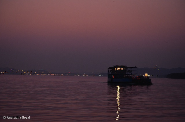 Ferry plying across at dusk