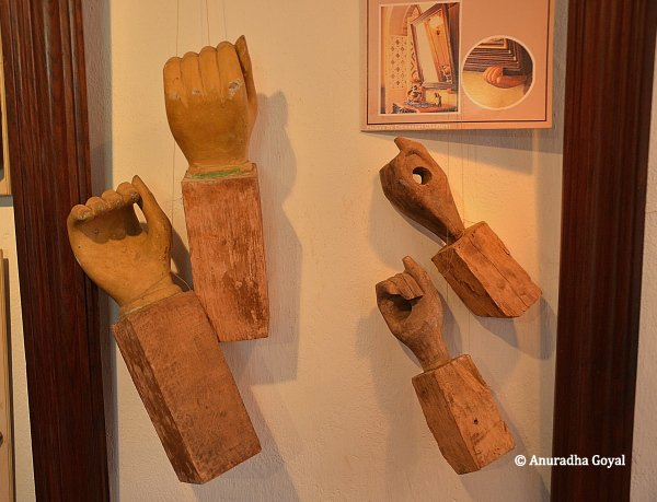 Wooden frames in the shape of hands to hold paintings
