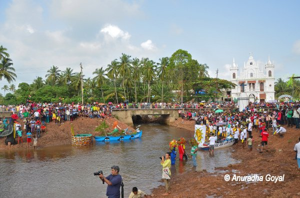 Church, River and the Crowds celebrating Sao Joao