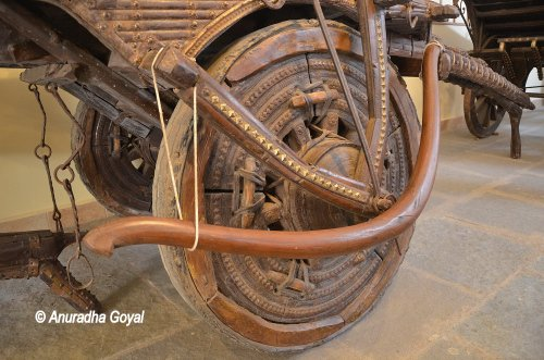 Intricately carved wooden Wheel at Goa Chakra Museum