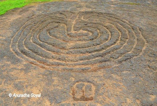 Prehistoric carvings on laterite rocks at Pansoimol