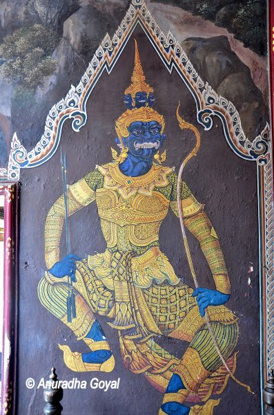 Rama is depicted in blue with his bow and arrow
