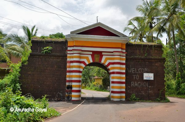 Colorful arch built of laterite stone wall at Rachol