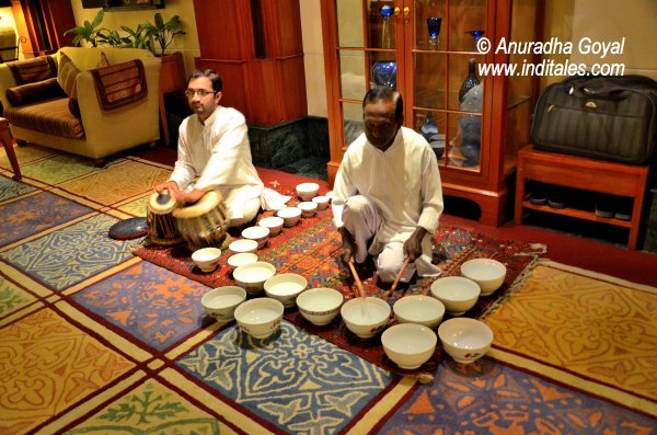 Musicians performing live Jal Tarang at WelcomHotel
